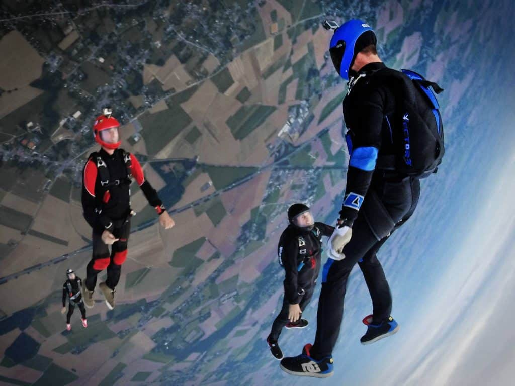 action camera - three people skydiving